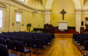 church in concert style facing the stage and screen