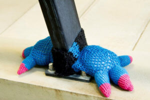 dinosaur feet yarn tied to hand rail